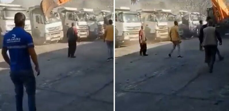 Moment furious coal miner destroys trucks with digger amid wages row with boss