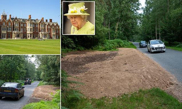Queen builds MUD barriers at Sandringham estate, removing free parking