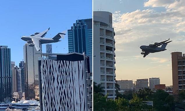 RAAF C-17 cargo jet weaves through skyscrapers in Brisbane's CBD