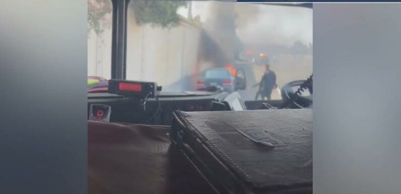 Rookie California police officer pulls man from car that burst into flames