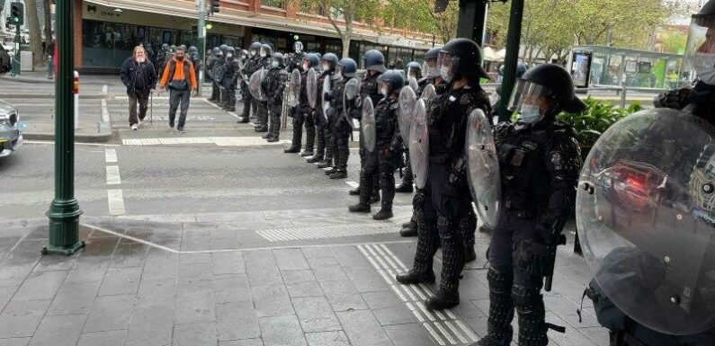 Standoff at Shrine ends in cloud of teargas and hail of non-lethal rounds
