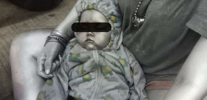 Warped mum lets beggar paint her baby SILVER and cradle it in the street so they can both rake in cash