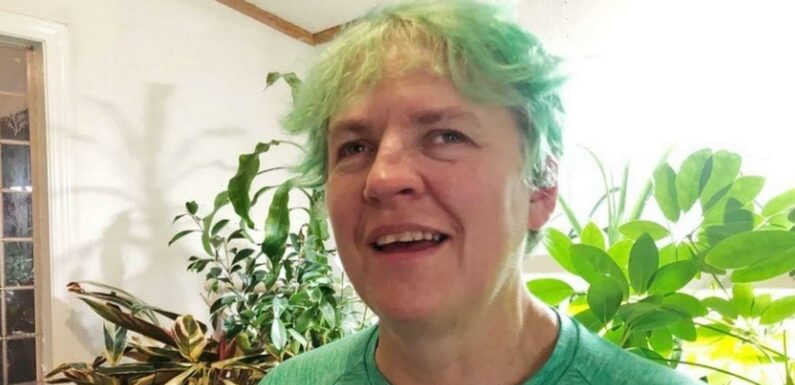 Woman's blindness cured after DNA edited – and she dyes hair green to celebrate