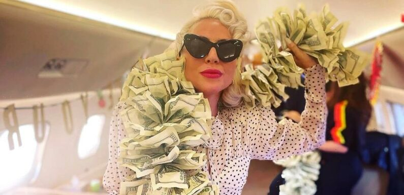 'Vegas Baby!' Lady Gaga Wears Boa Made of $100 Bills on Private Jet