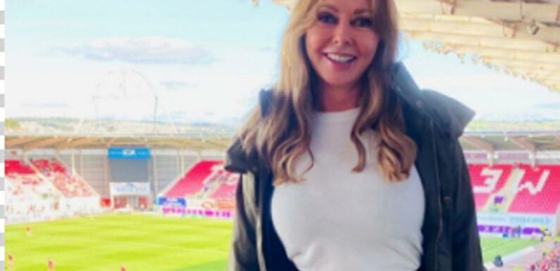 Carol Vorderman, 60, wows fans as she poses in skintight red trousers for day at the rugby