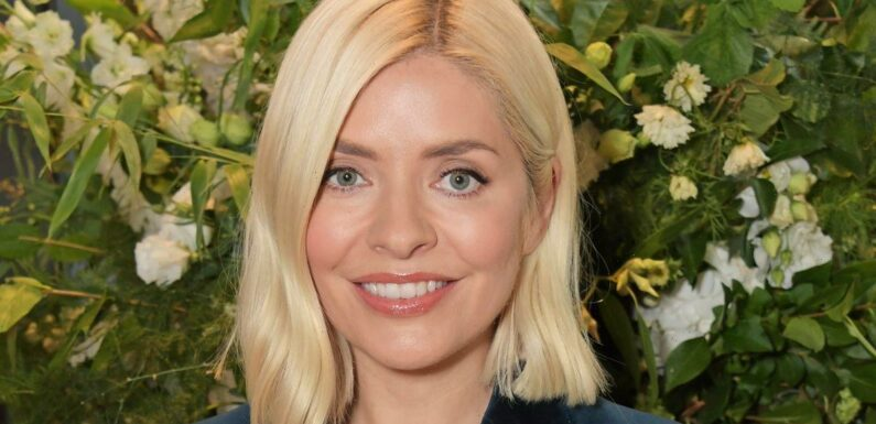 Holly Willoughby is super stylish in velvet suit at launch of her £45 candle range
