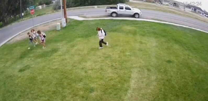 Man divides opinion by setting off sprinkler on people who step on his lawn