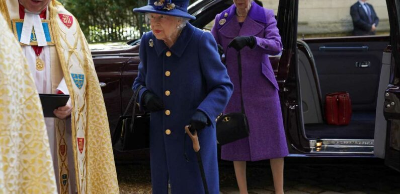 Queen looks majestic in blue as she heads to Westminster Abbey with walking stick to honour British Legion