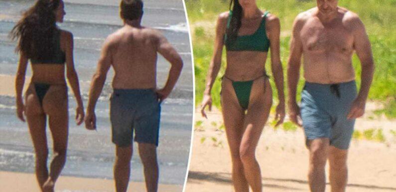 Shirtless Gerard Butler hits the beach with on-again girlfriend Morgan Brown