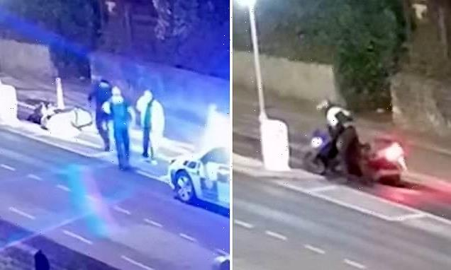 Teenager is caught on CCTV carefully staging a motorbike crash