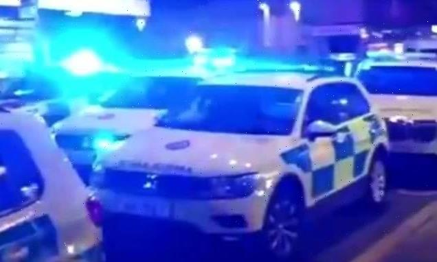Three men are rushed to hospital after barber shop shooting in London