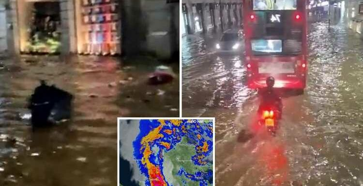 UK weather: London's streets FLOODED after an inch of rain deluges city in an HOUR – and there's more to come